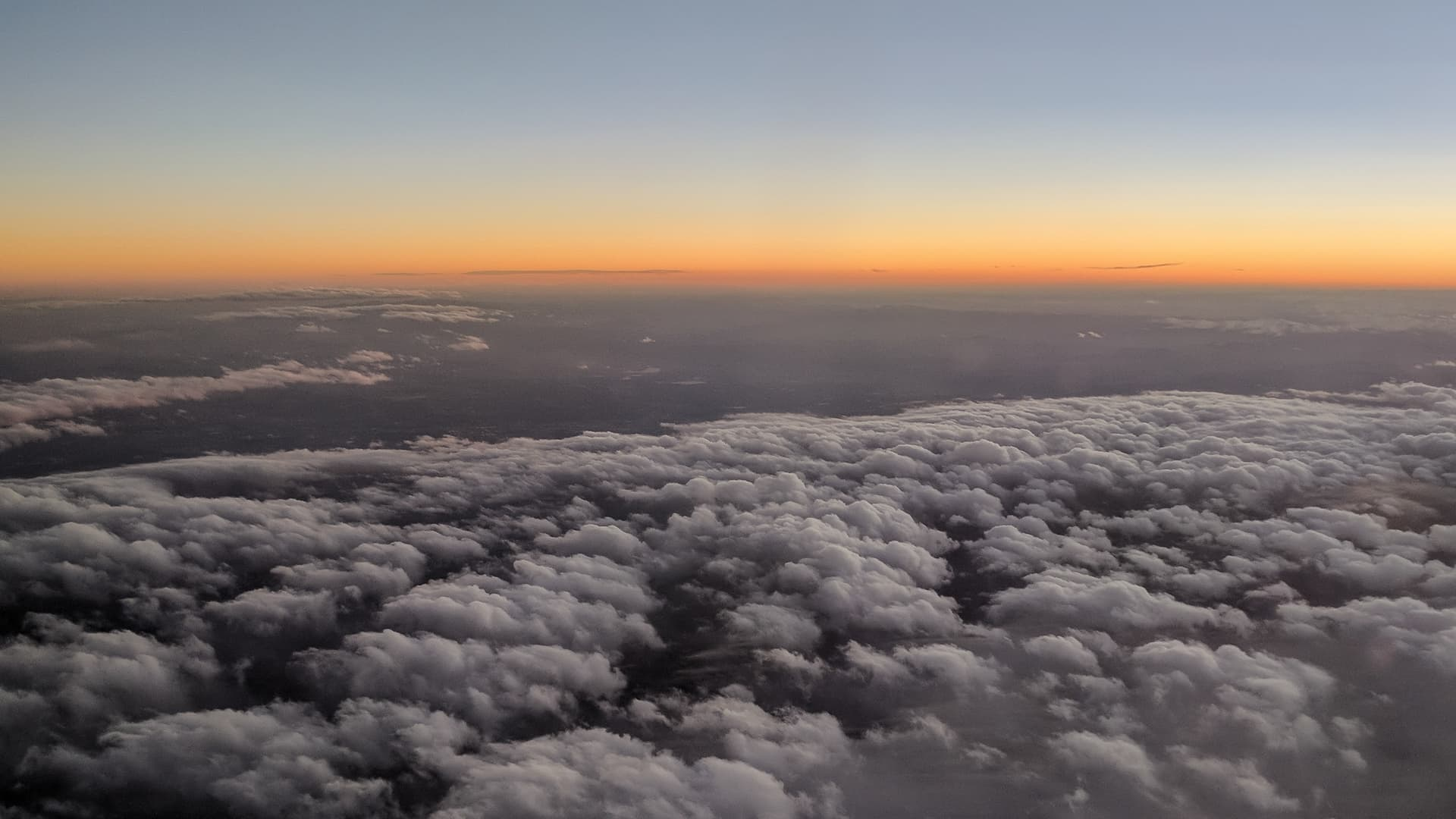 Sunset over the American Midwest as seen from a plane.