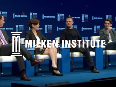 People sitting inside a conference hall at the Milken Institute
