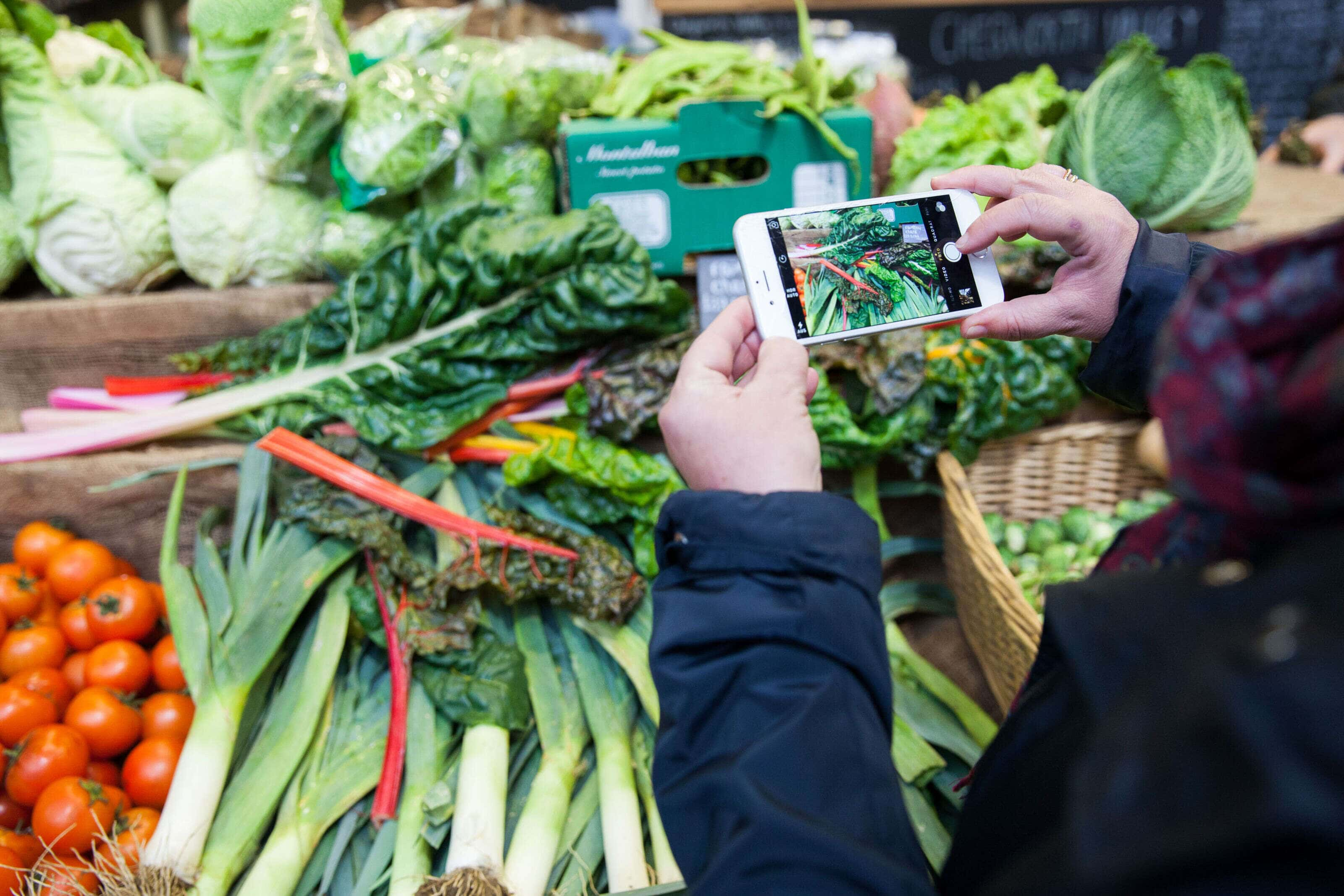 image of an iphone screen taking an image of veg and fruit.