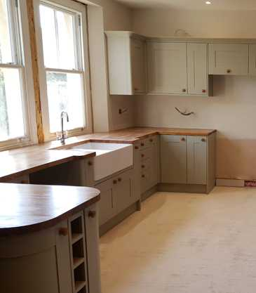 Kitchen units being installed and readying for first fix