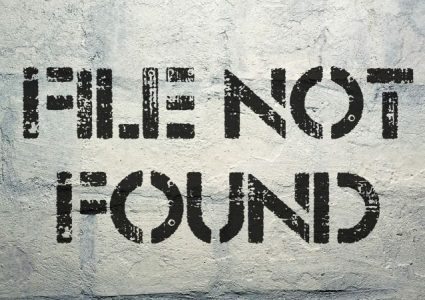 A brick wall with a graffiti that reads 'file not found'.