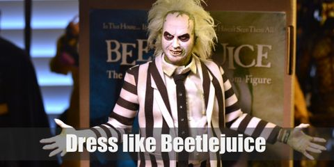 Beetlejuice wears an iconic black and white-striped suit that makes him look like half a salesman and half a prisoner. He has wild, messy, thin, green hair and his complexion is white.