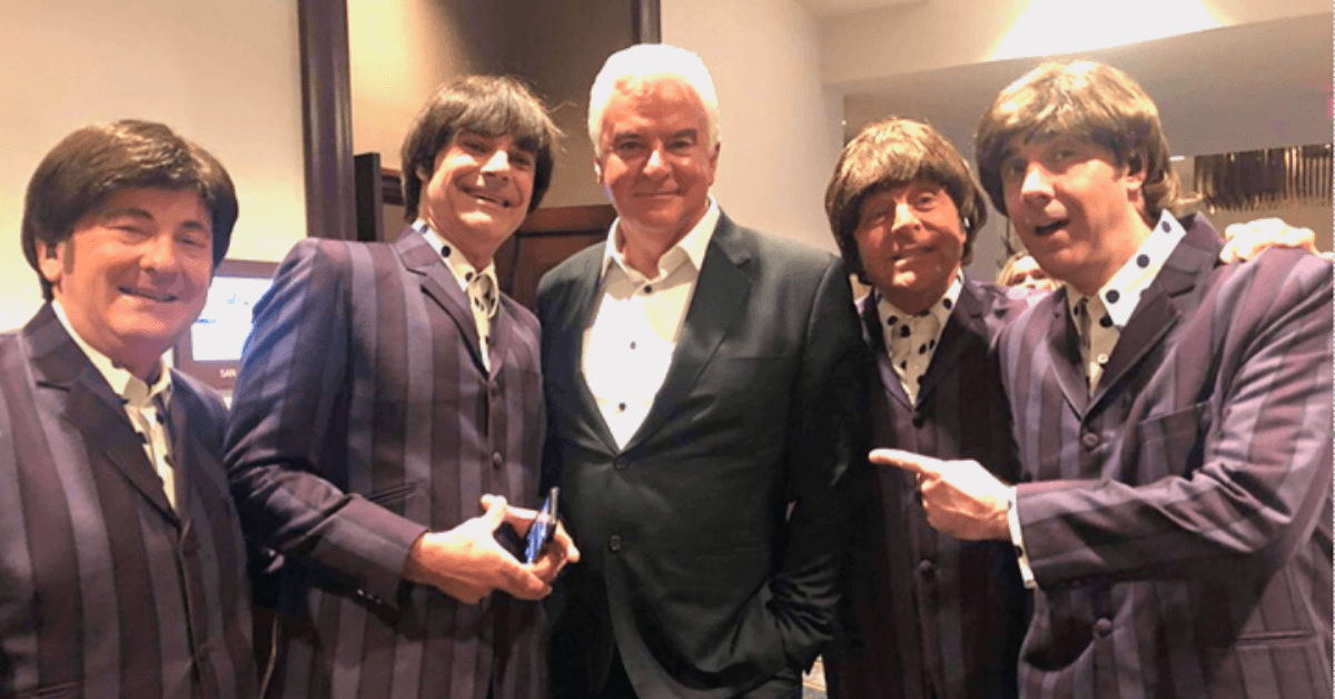 A photo of John O'Hurley and the members of the band Sixtiesmania at the 2021 PM Group Kings and Queens of Good Hearts Gala