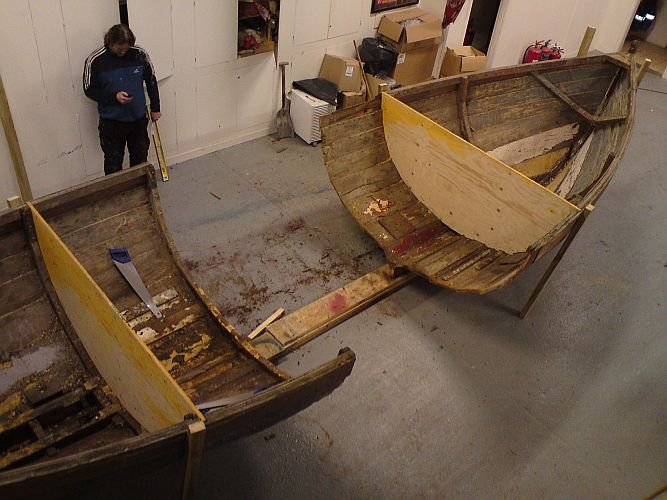 Work begins by cutting the boat in half
