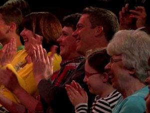 Audience members applauding