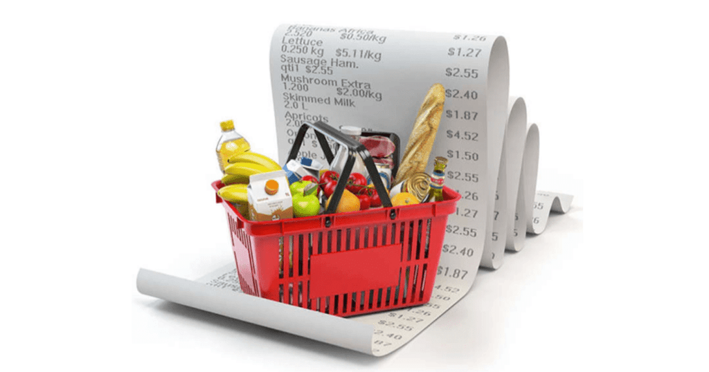 An image of a red shopping basket with produce and a big receipt behind it