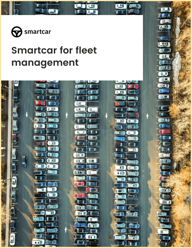 Front-page of Smartcar's fleet management white paper showing rows of parked cars in a parking lot from a bird's eye view