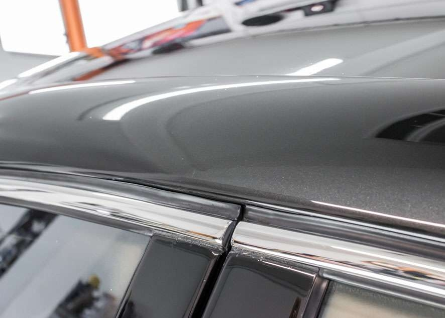 Close up shot of Bentley Flying Spur car after paint correction, paint correction and paint enhancement with no scratches