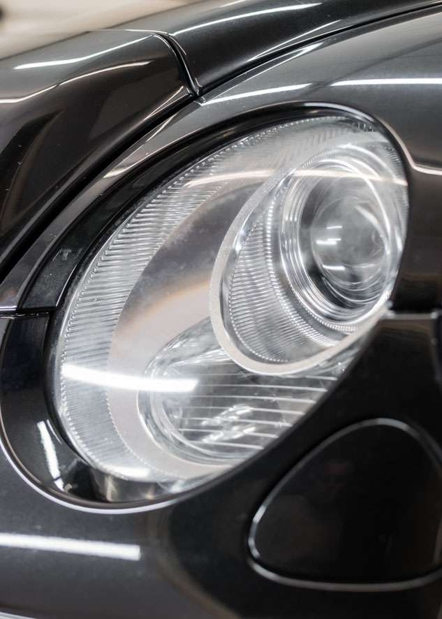 Close up shot of right side Bentley Flying Spur cloudy/foggy headlight before headlight restoration