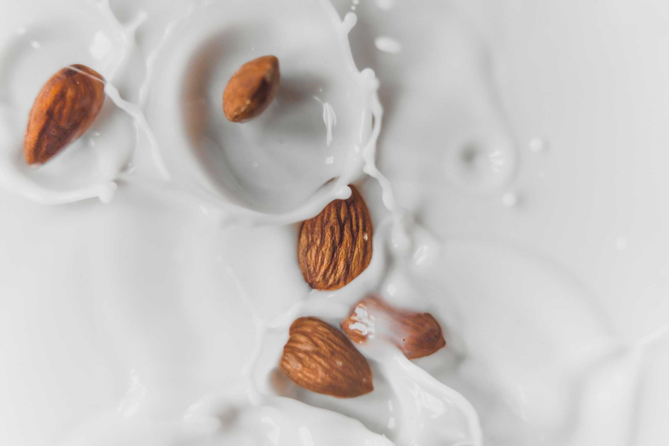 Almond milk with almonds. Plant-milk alternatives pose environmental questions