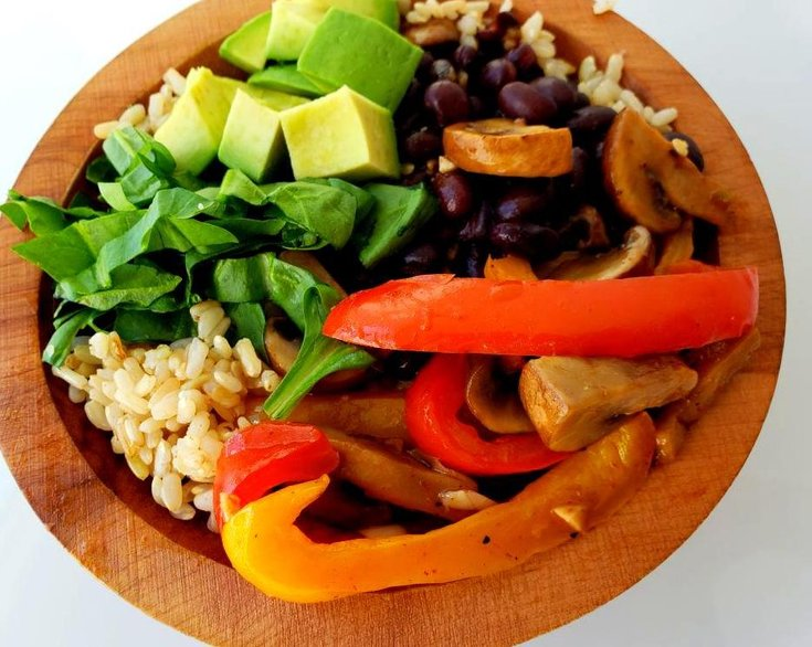 Bowl with fajita vegetables and black beans over brown rice