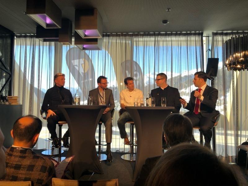 Eric Kryski moderating a panel in Davos at CV Summit