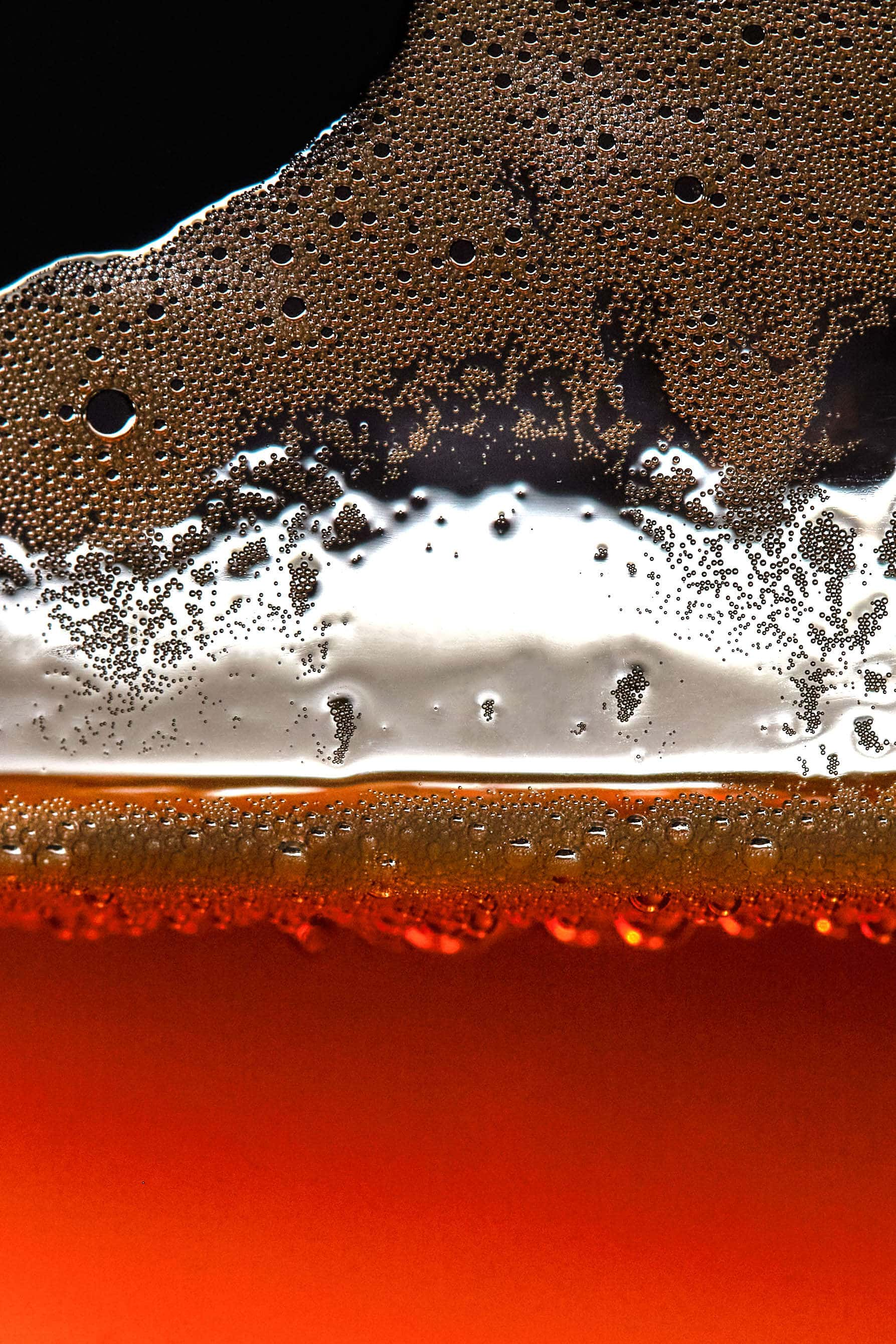 bubbles on side of glass of beer