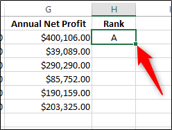 An Excel worksheet with one cell highlighted and annotated with a red arrow