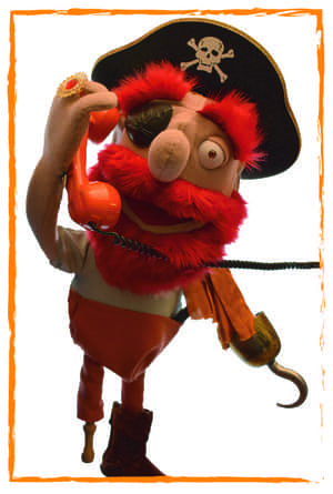Pirate puppet using a telephone.