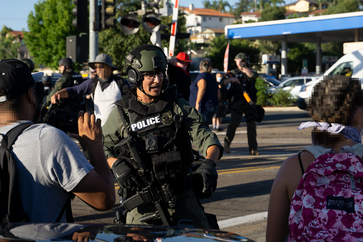 A SWAT officer with an M4 intervenes in the brawl. Photo by Tom Mann.
