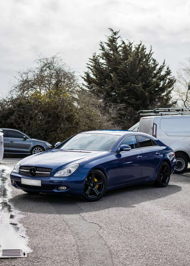 Blue Mercedes CLS after vinyl car wrapping from grey colour