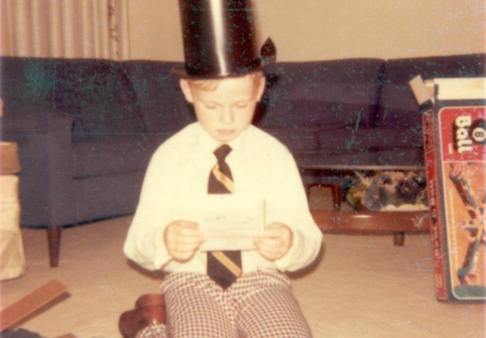 Picture of Brad Brown as a child with a magic set