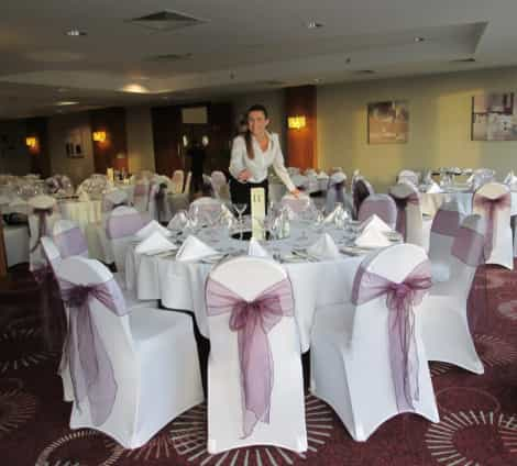 Claire, the creative director of my weddings rock is putting the final touches into decorating a table