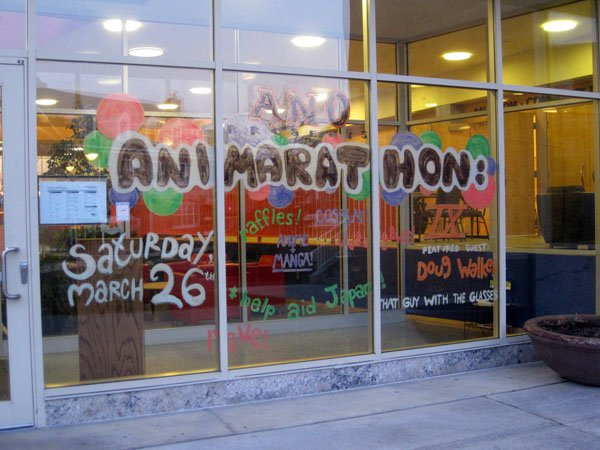 Animarathon IX announcements painted on the exterior windows Bowen Thompson Student Union.