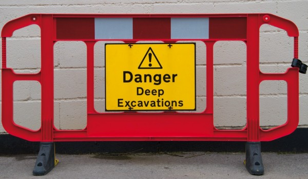 Titan barrier with warning sign