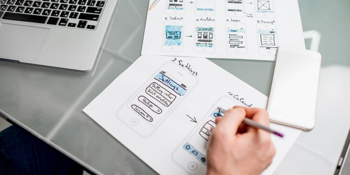 A web developer reviewing designs from the design team