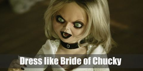 Chucky transfers Tiffany's soul into a bride doll. She then gives herself a makeover; changing her hair to blonde and making her wedding dress look chic while adding an edgy black leather jacket.