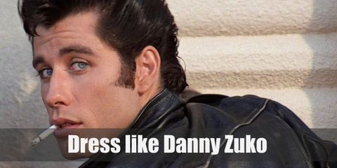 Danny Zuko is always wearing a T-shirt tucked into black jeans with a black belt topped with his black leather jacket with the T-Birds logo on the back, and black penny loafers.