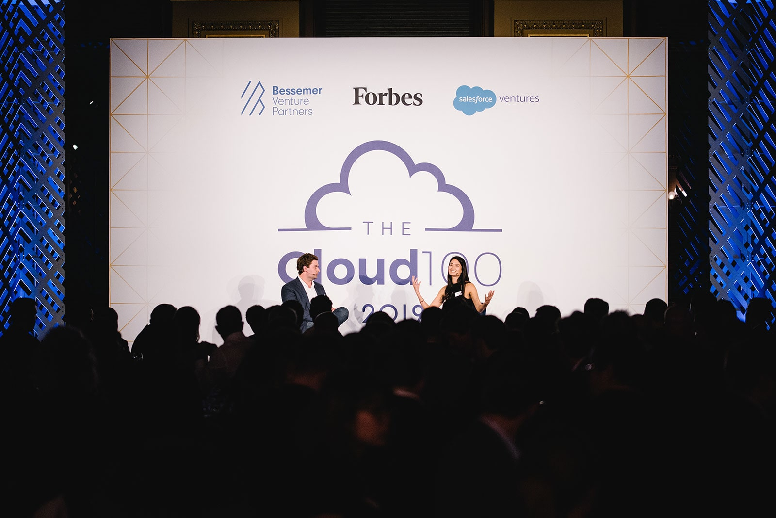 Alex Conrad of Forbes and Melanie Perkins of Canva on the Cloud 100 2019 stage
