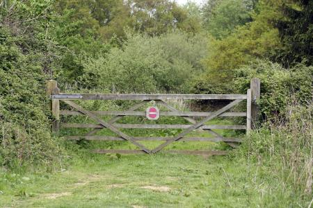 Gate with 'no entry sign' on it, blocking access to the driveway, from mailsparky of FreeImages
