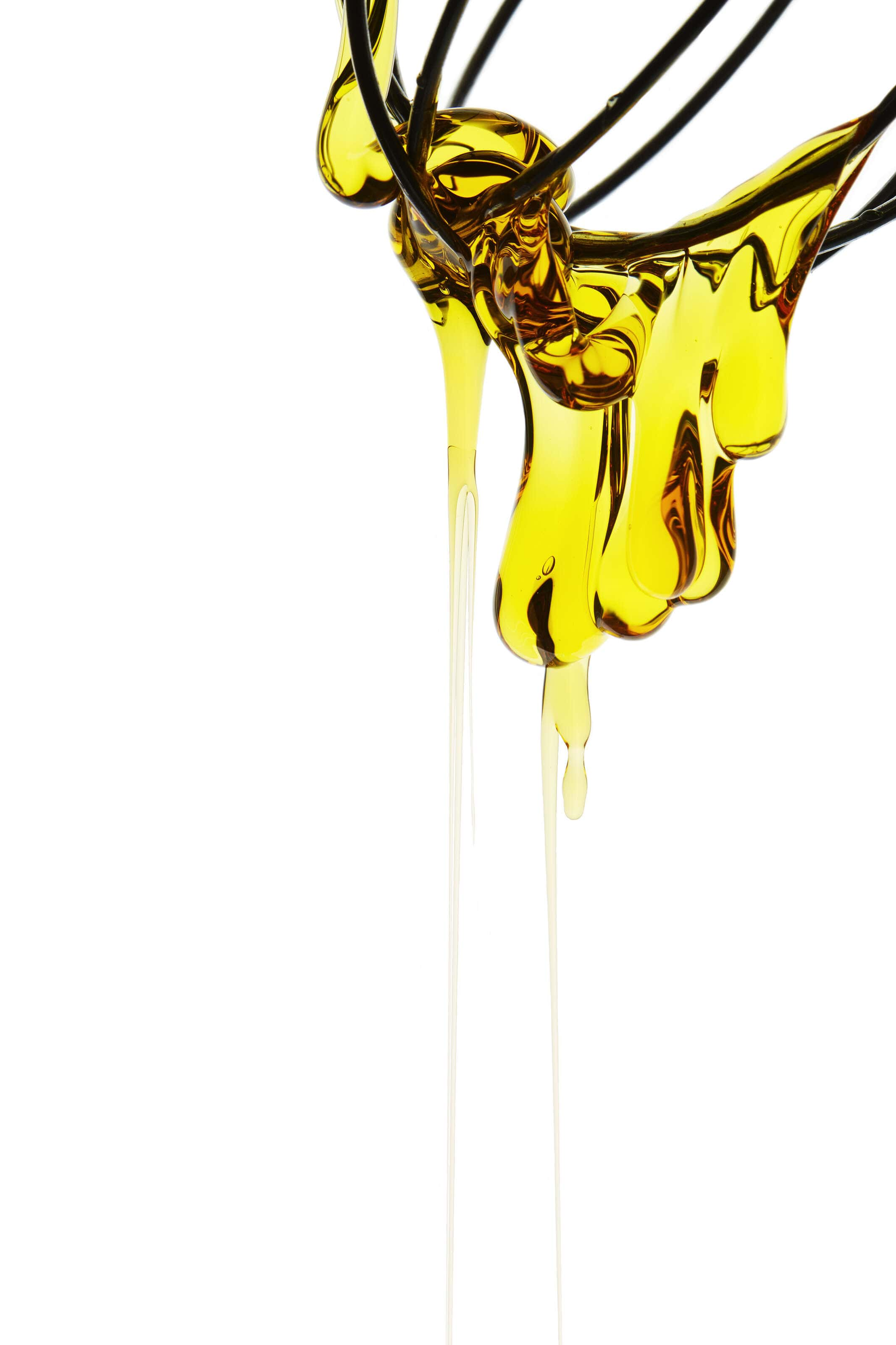 golden-syrup blob dripping off whisk