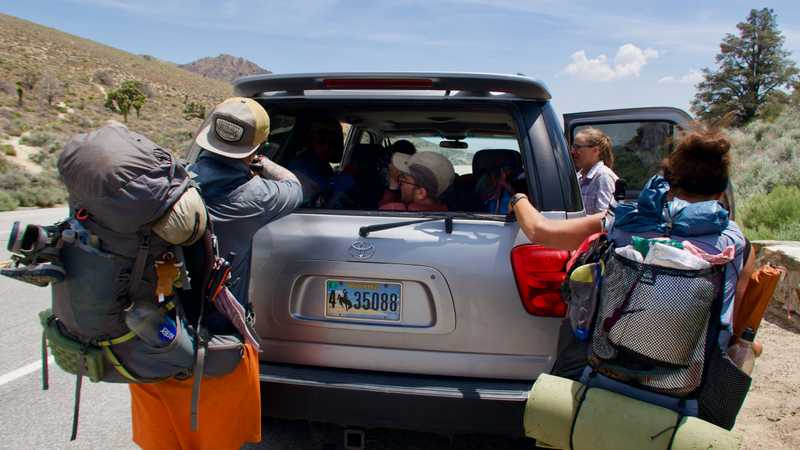Climbing into shuttle driver's car at Walker Pass