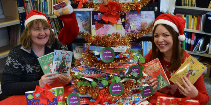Staff members Kate Bacon and Sherryl Goldsmith with our festive books