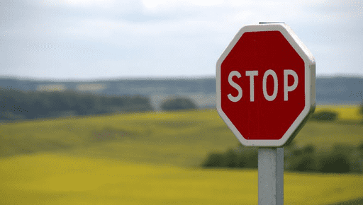 Stop sign acts as roadblock in front of grass and hills and fields. Is annoying. #Advisory