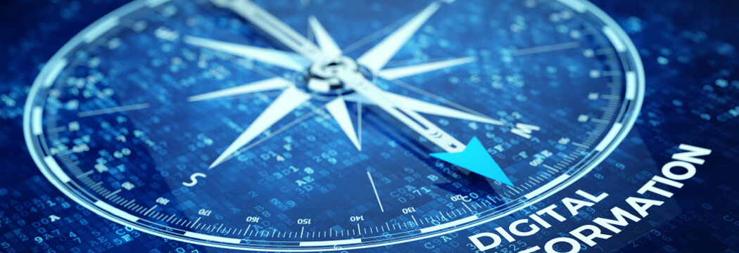 A compass pointint to digital transformation.
