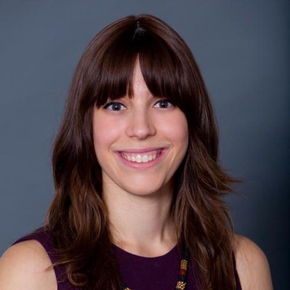 Professor Leia Saltzman - smiling and wearing a purple shirt