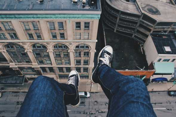 Feet dangling from roof