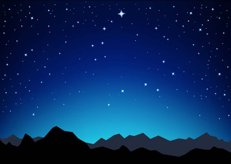 Starry night sky against a mountain backdrop