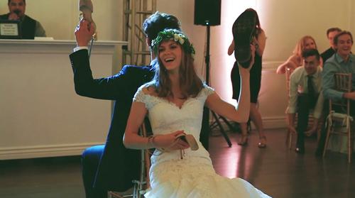 Amelia laughing at wedding reception game