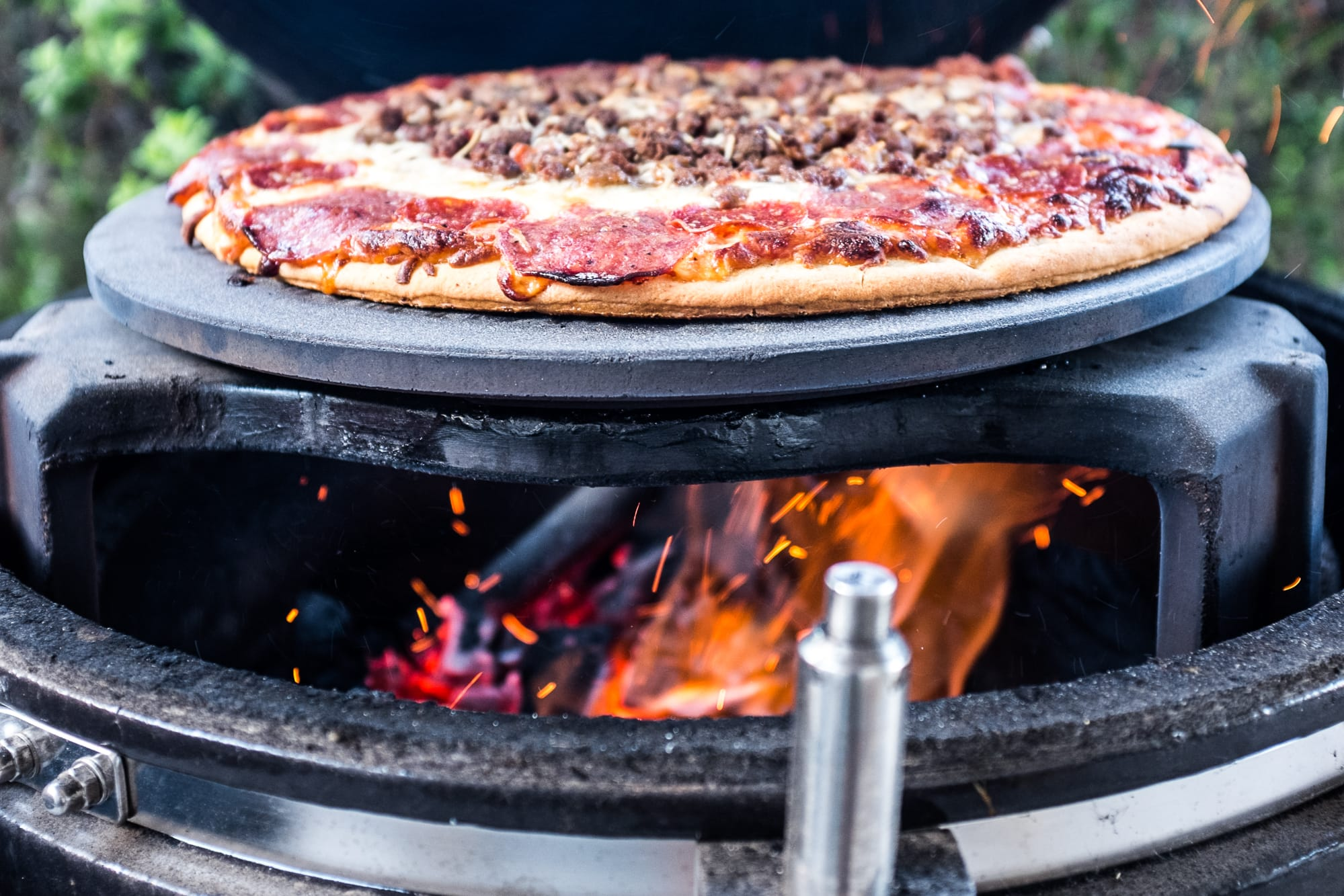 Costco Take'n'Bake pizza in the process of turning into deliciousness with fire