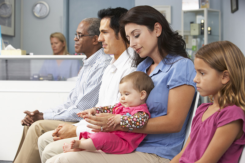 Multiple people in a doctor's office waiting room