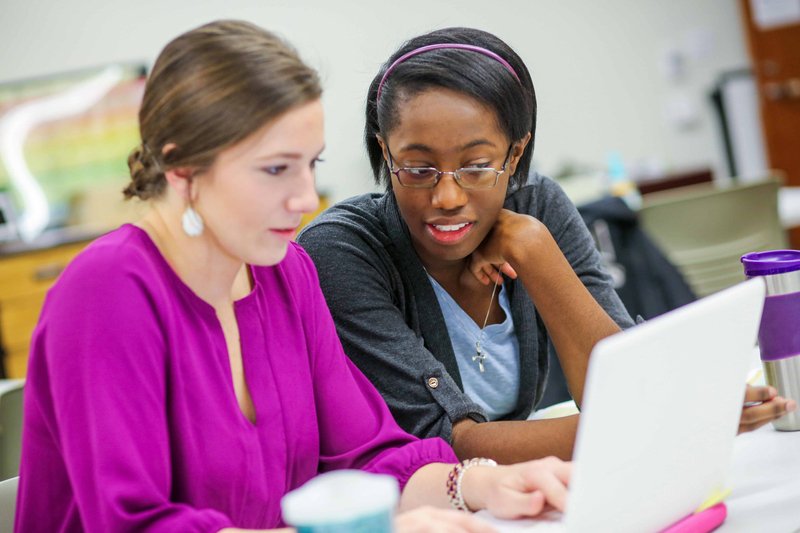 Two Baylor University students studying on a laptop