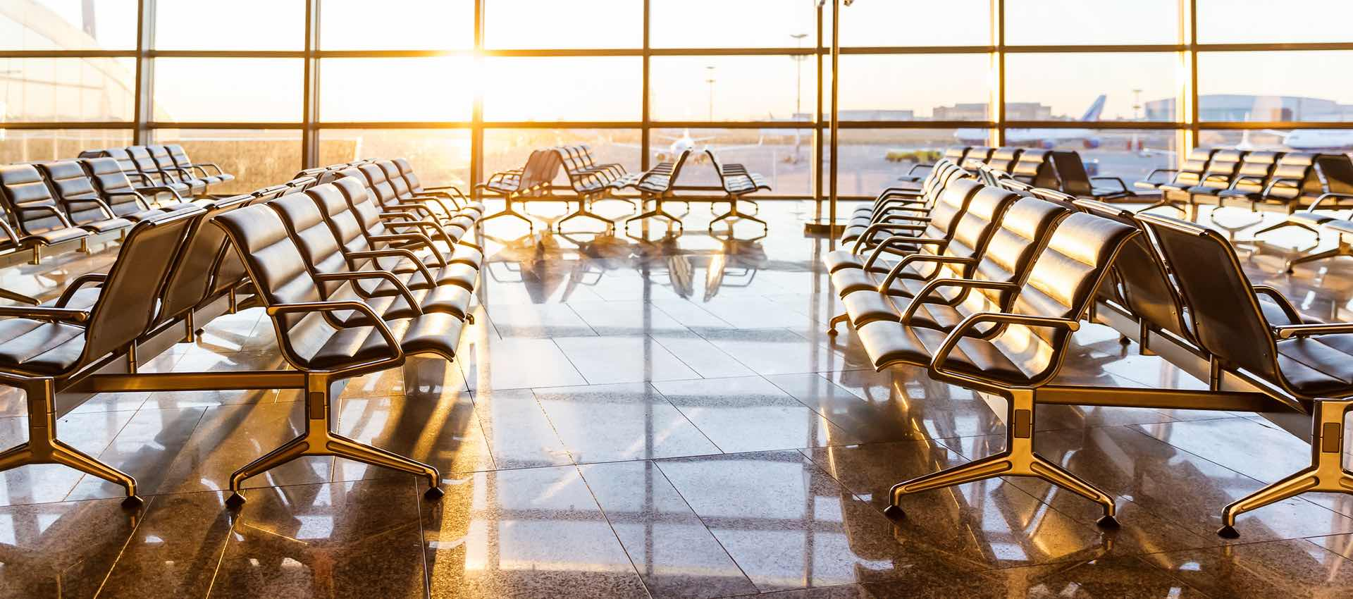 Clean airport departure lounge at sunrise