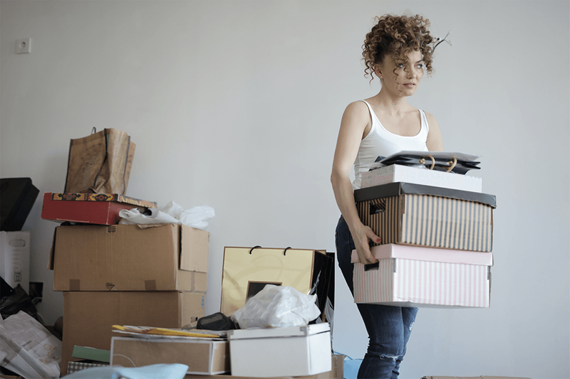 A lady moving several boxes.