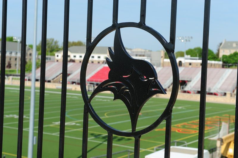Image of a metal bird on a stadium gate on campus