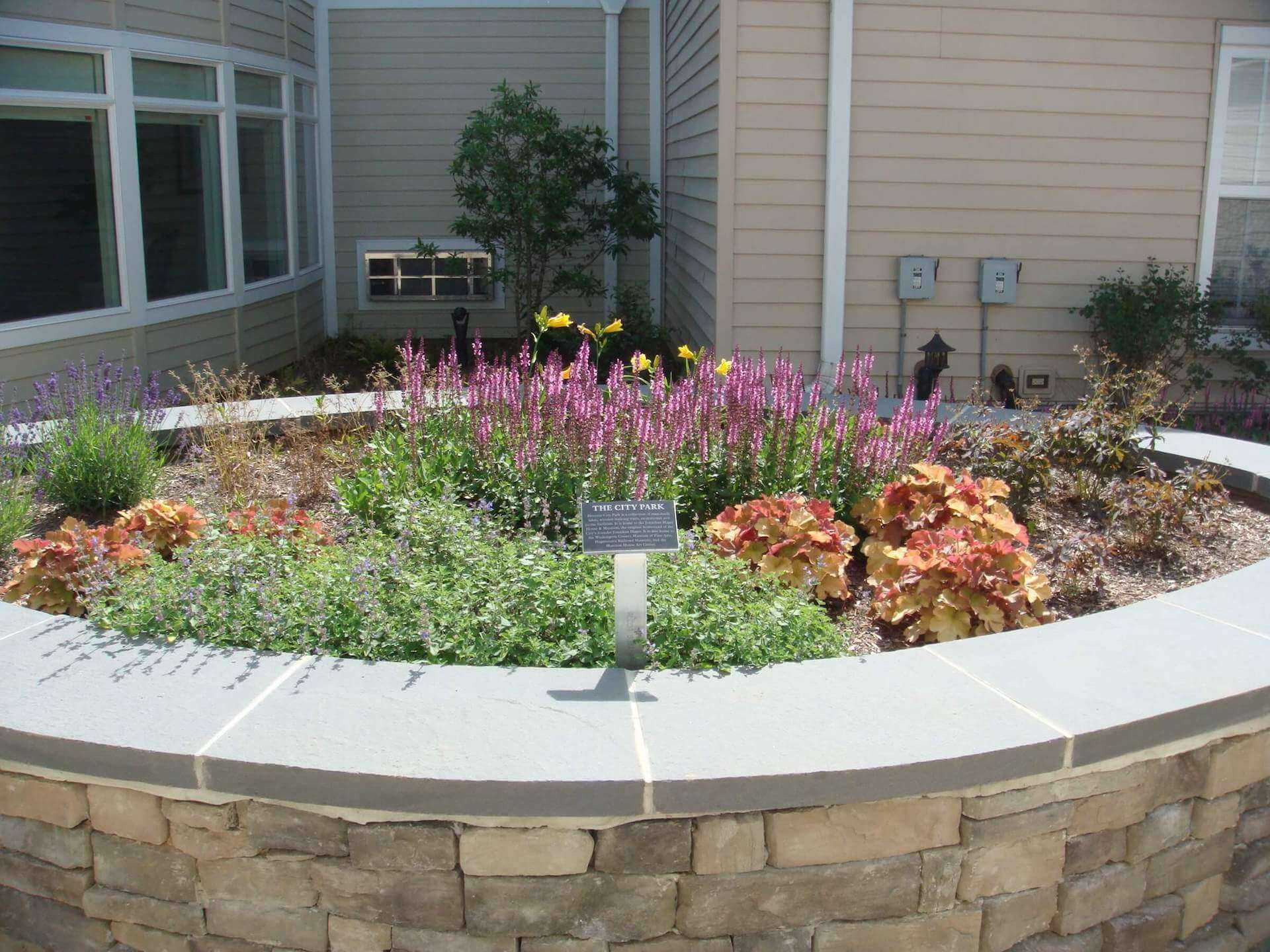 flower bed in the center of the landscaping area