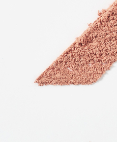 Finasteride - Light gray backdrop with a deep red, course powder shaped in a slanted rectangle at a forty five degree angle.