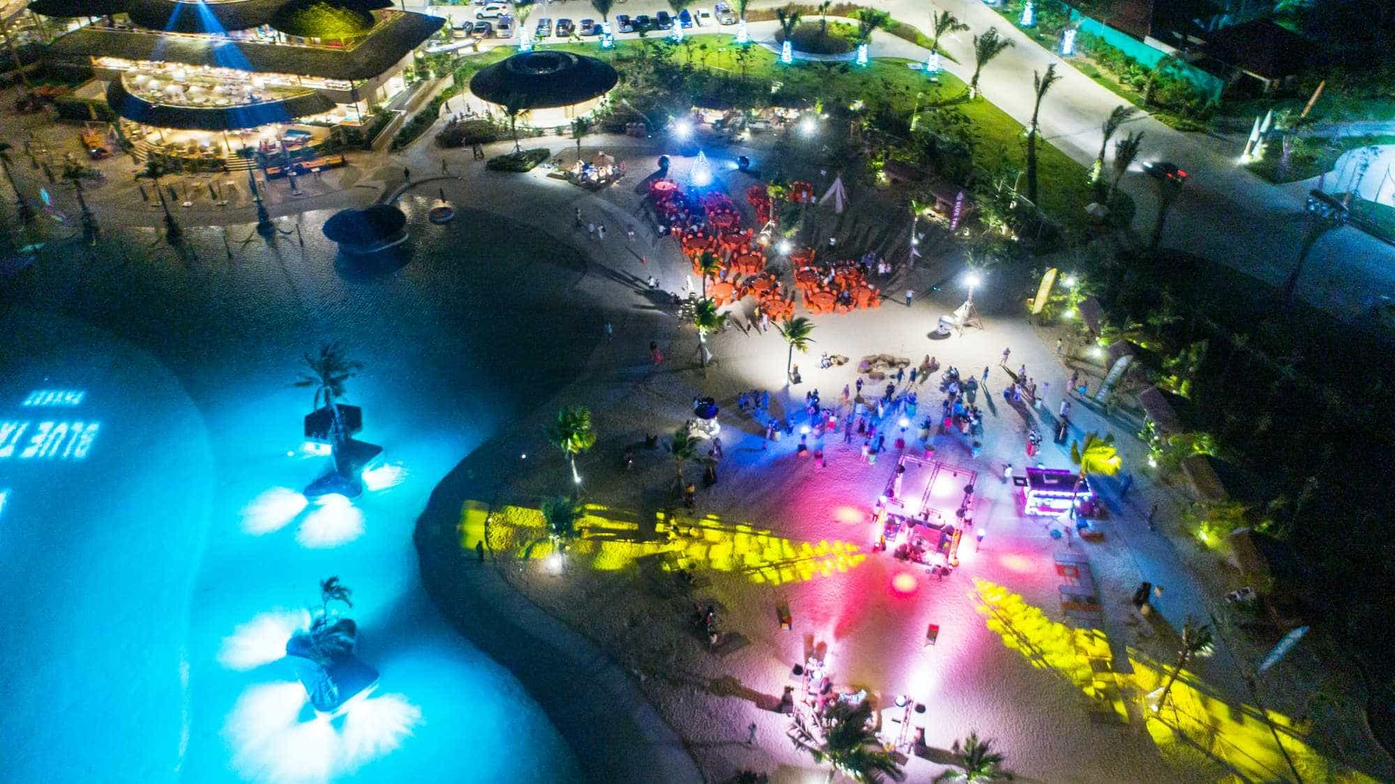 Ariel view of Blue Tree Phuket showing night time lighting design