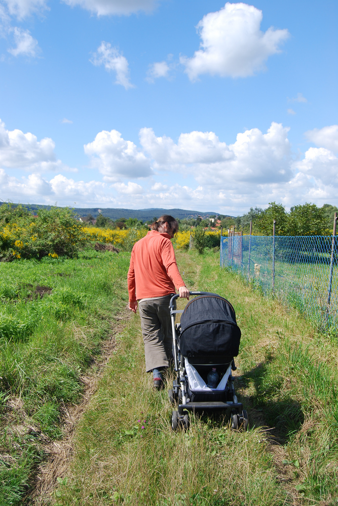 Me hubby with pulling the pram in the green