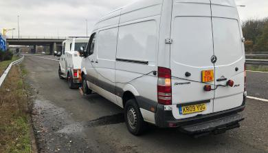 APJ (UK) LTD recovering a large van on a motorway